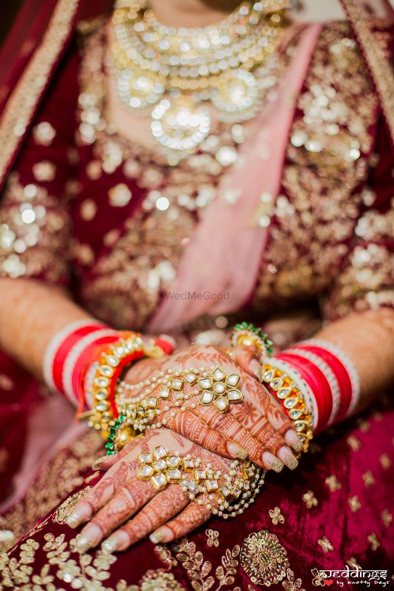 Photo of Bridal hands with mehendi and haathphool