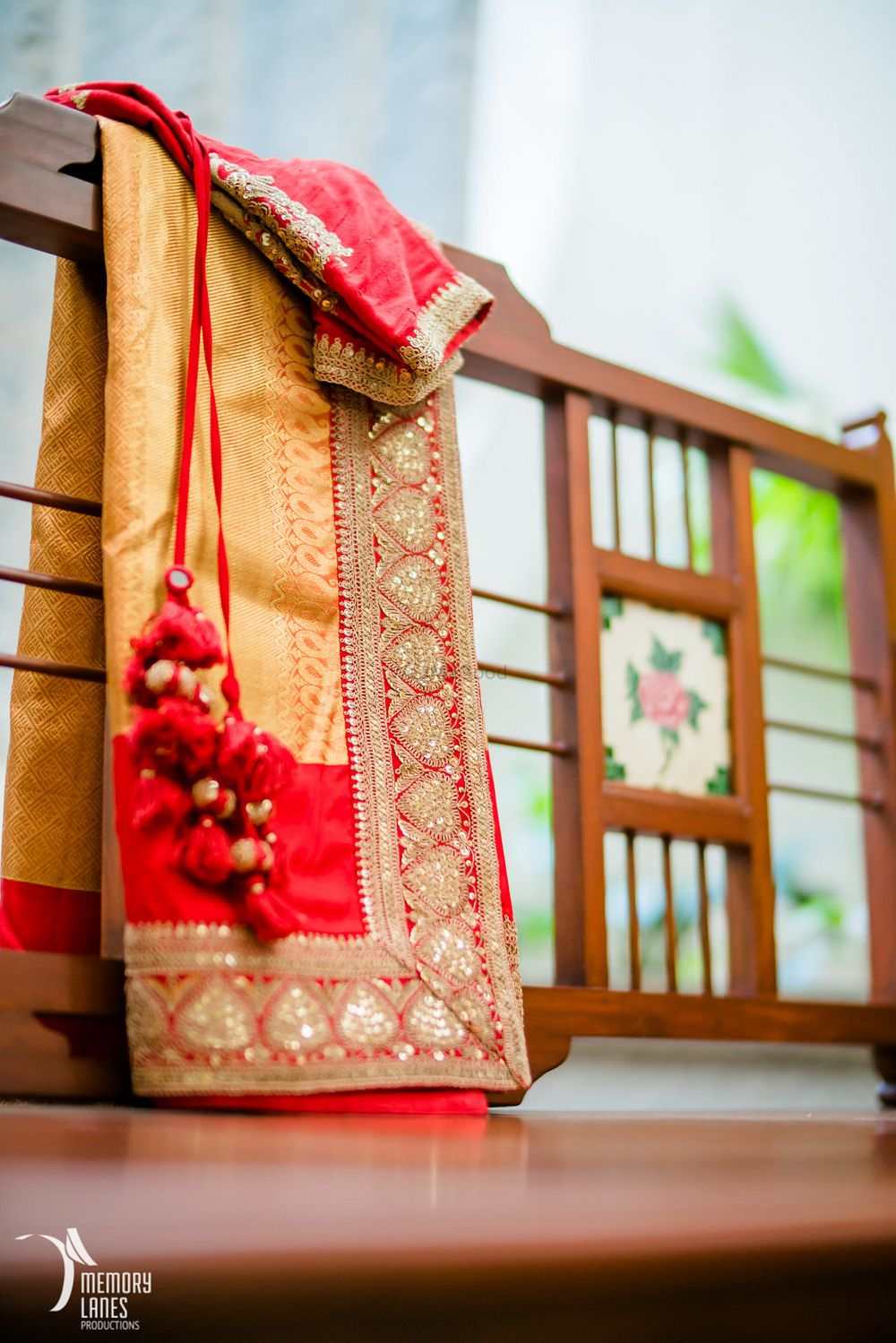 Photo of Gold and Red Saree with Red Latkans