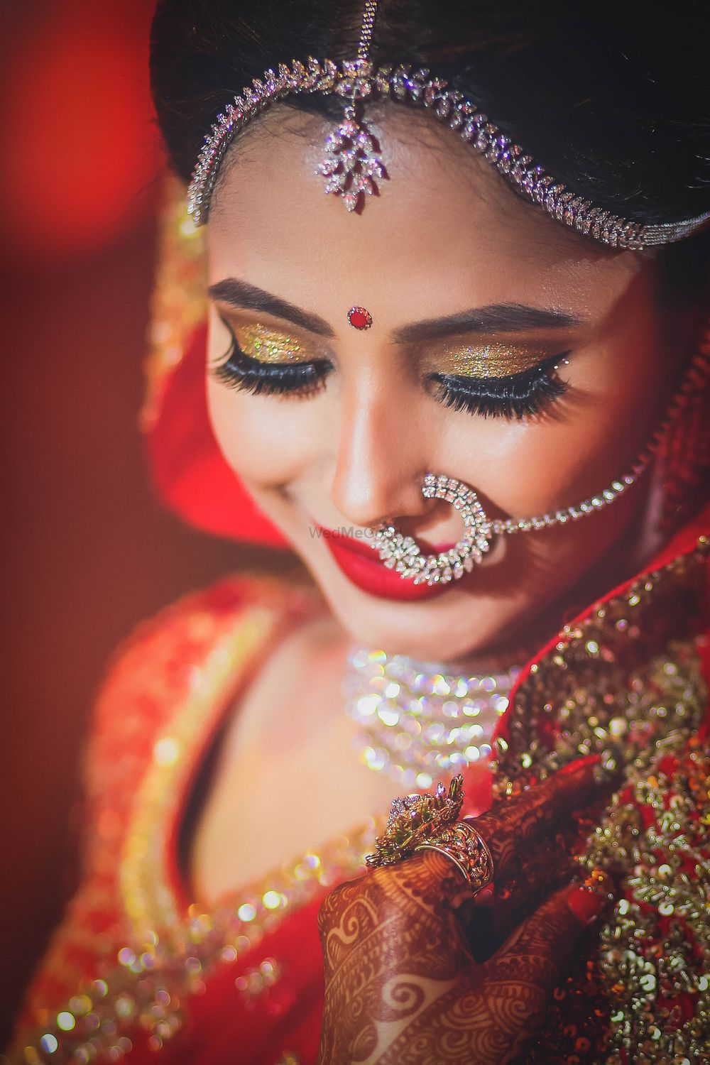 Photo of Beautiful bridal makeup with gold shimmer eye makeup