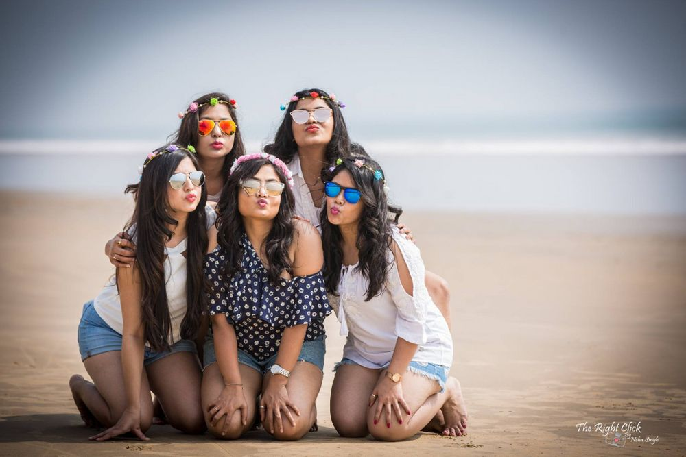 Photo of Bride with bridesmaids on beach