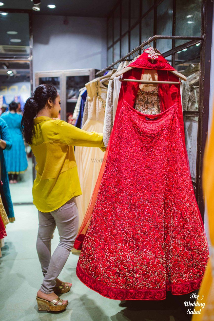 Photo of Red Threadwork Bridal Lehenga on a Hanger