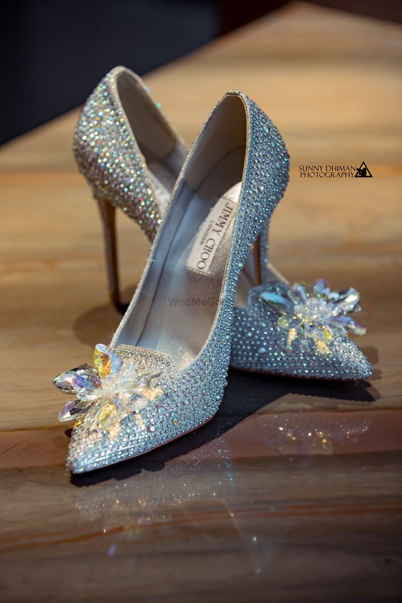 Photo of Light blue and silver studded jimmy choo shoes for bride