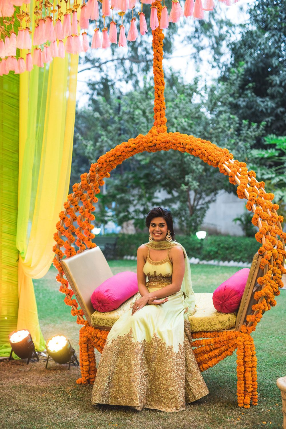 Photo of Mehendi bridal seat decor with genda phool