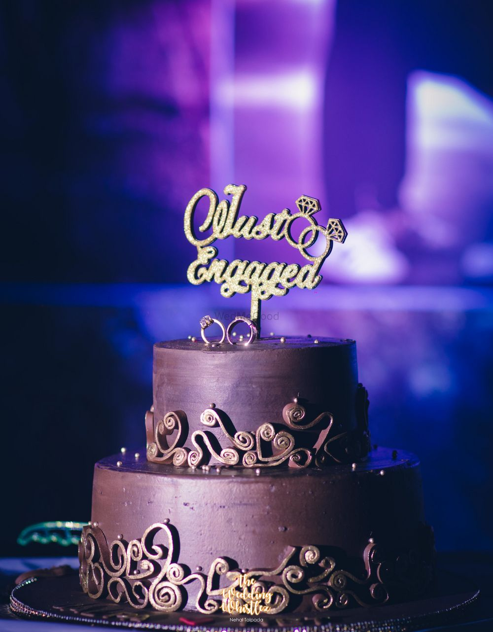 Photo of Brown wedding cake with just engaged topper