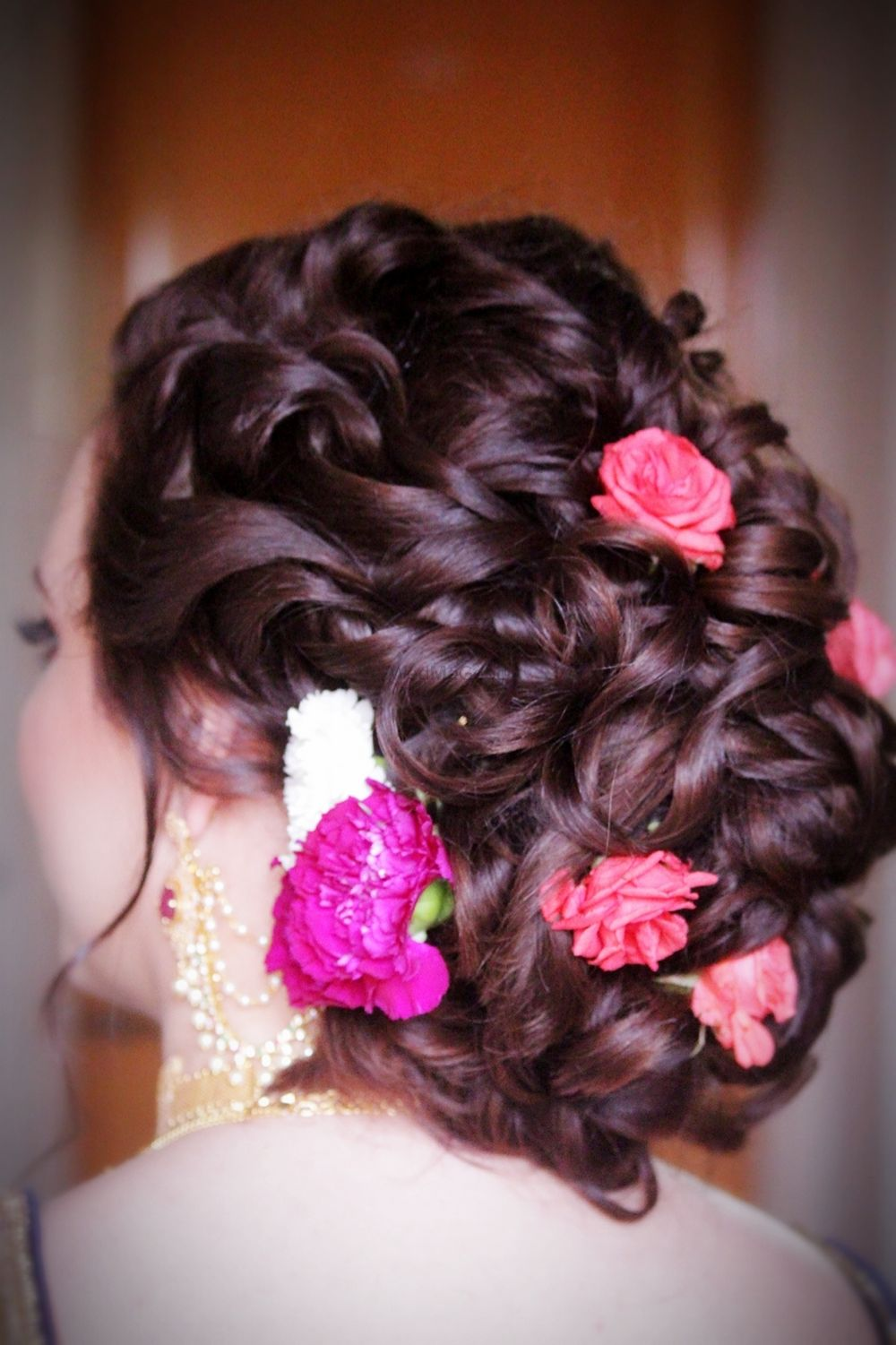 Photo of Bun with flowers for bride or mom