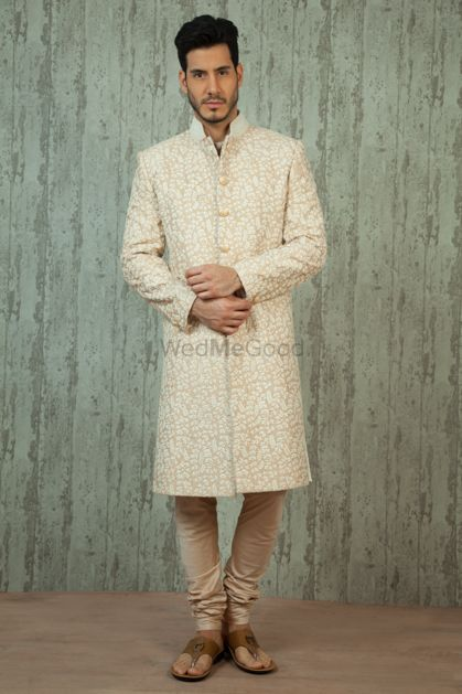 Photo of cream and white sherwani