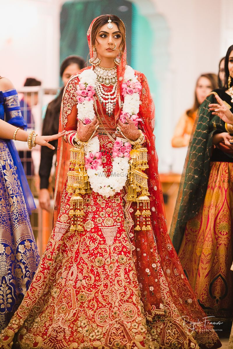 Photo of Red and gold embroidered bridal lehengas