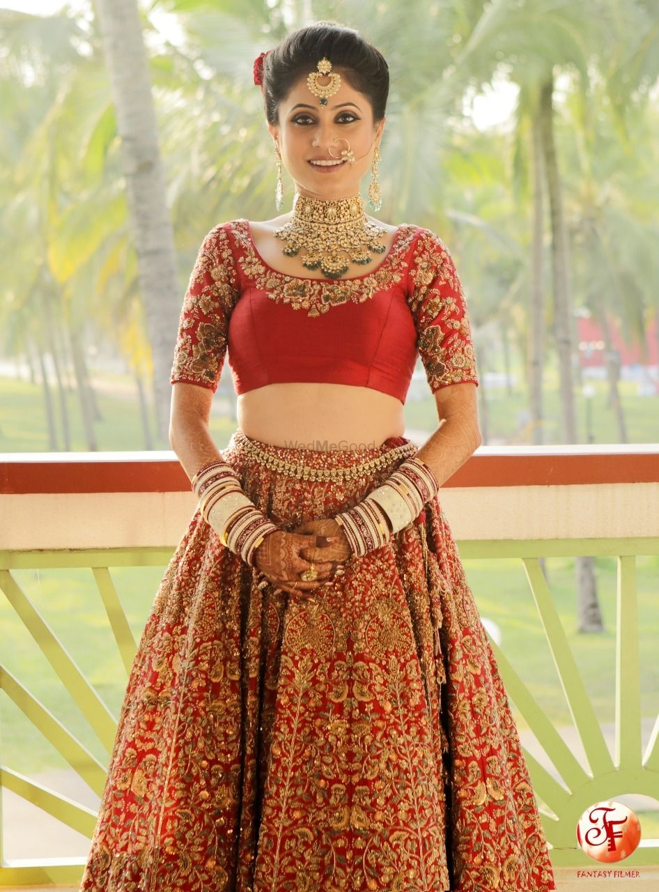 Photo of Getting ready shot with bride in blouse and lehenga
