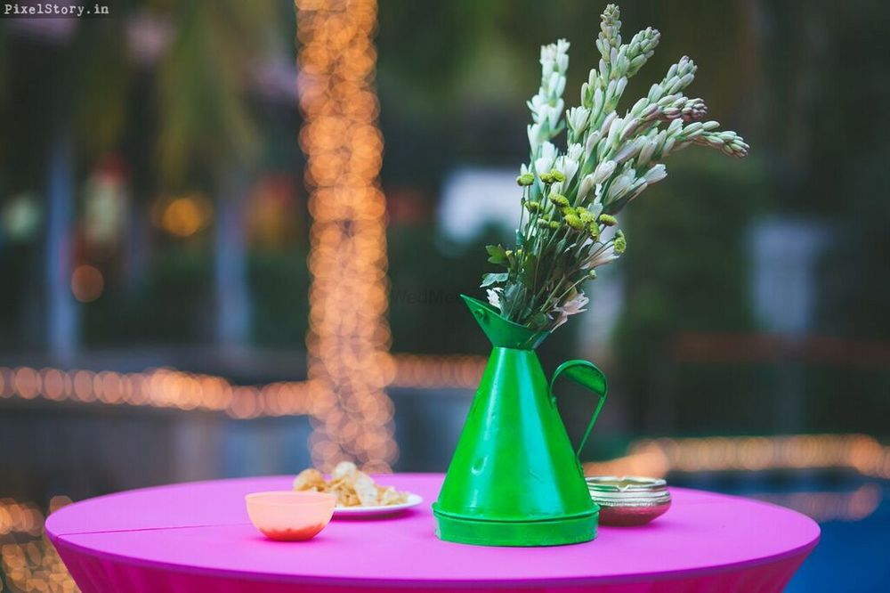 Photo of watering can table centerpiece