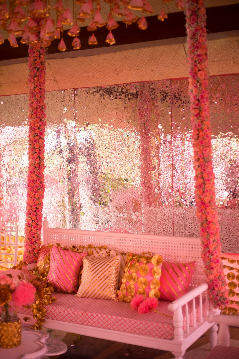 Photo of Bright pink decor for mehendi swing set