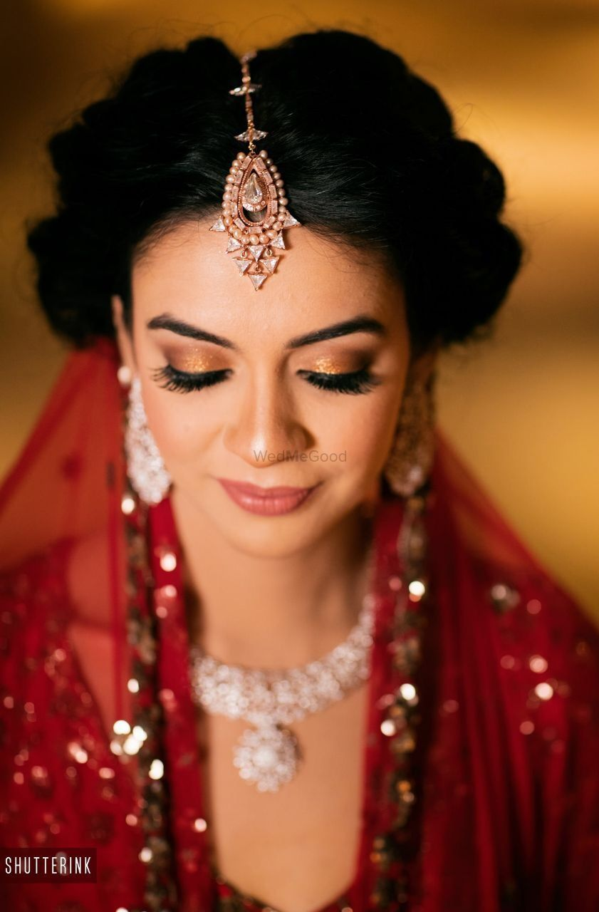 Photo of Simple and subtle bridal makeup with gold lids