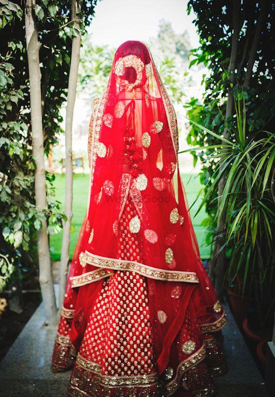 Photo of Bridal back red lehenga shot