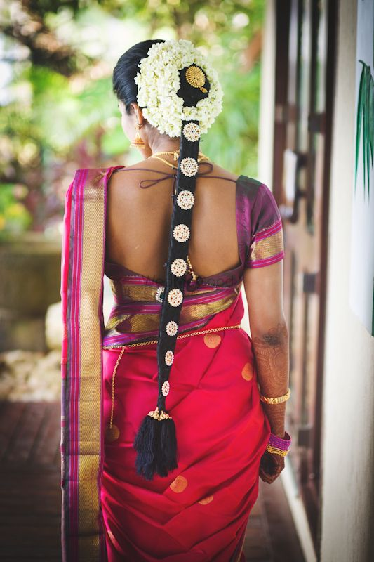 Photo of South Indian bridal braid with jewellery
