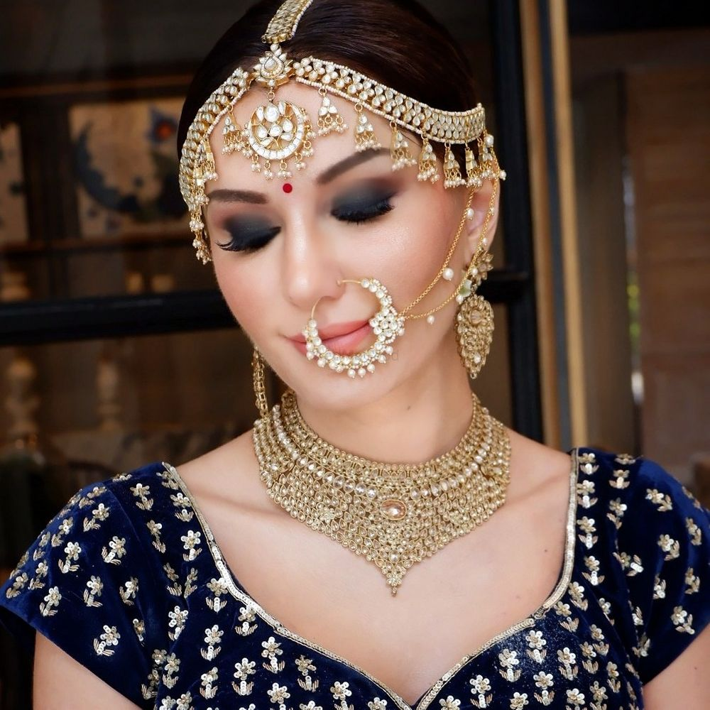 Photo of Gorgeous gold bridal jewellery with royal blue blouse