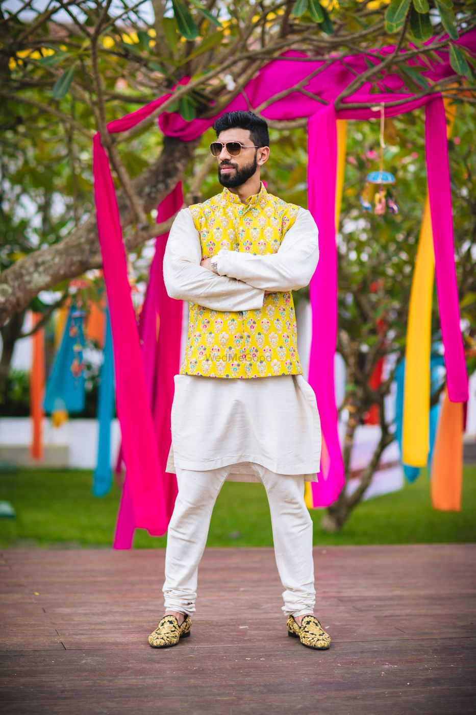 Photo of Quirky mehendi groomwear with yellow jacket over kurta