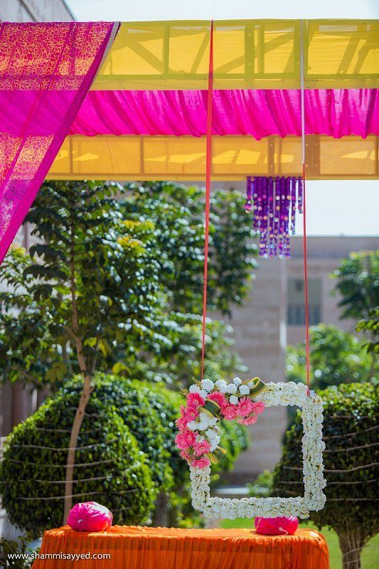 Photo of Pretty floral photo booth for mehendi