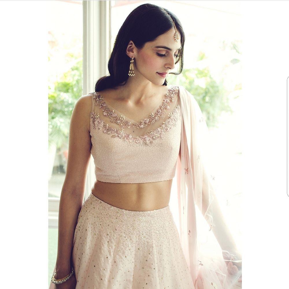 Photo of Blush pink lehenga with sleeveless blouse