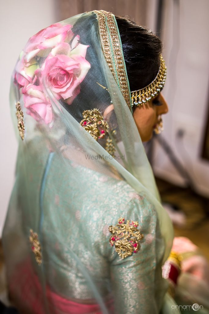 Photo of Unique bridal bun with big roses