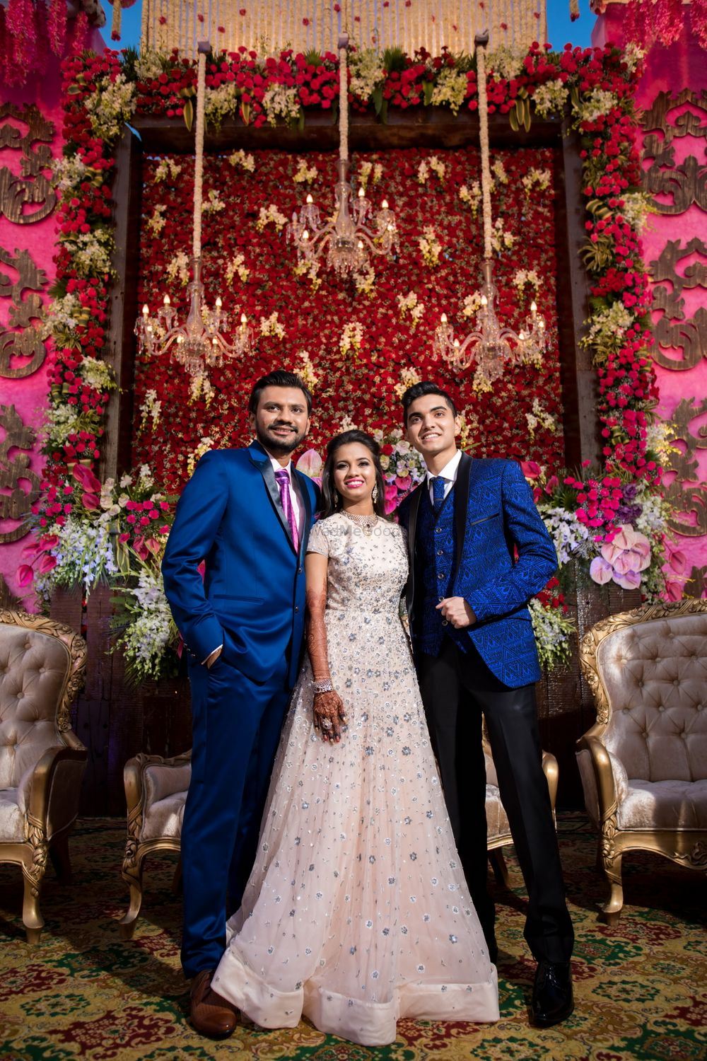 Photo of Engagement decor with floral wall and chandelier