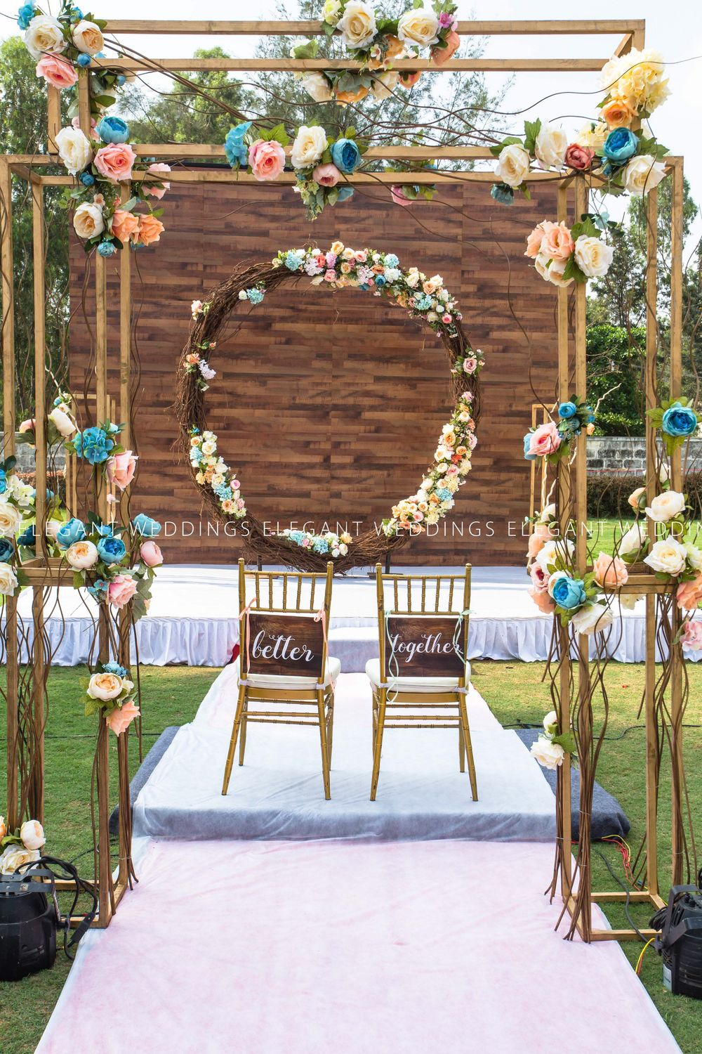 Photo of Floral wreath and couple chairs with simple mandap