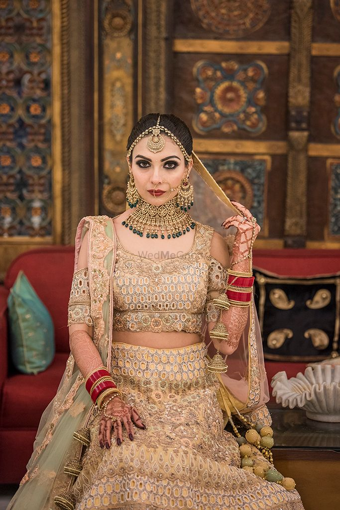 Photo of Beige lehenga with cold shoulder blouse