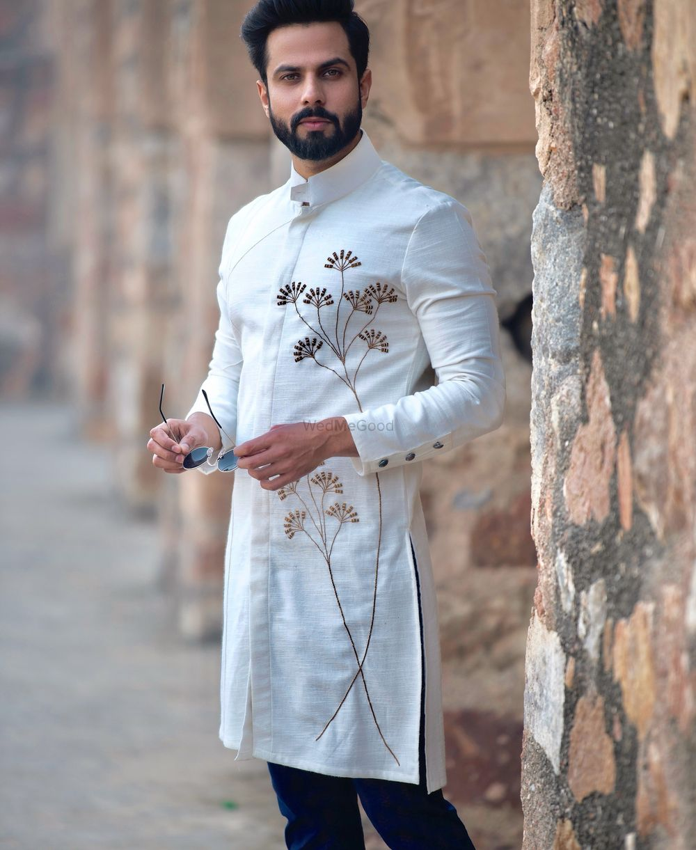 Photo of Modern groomwear with embroidered florals