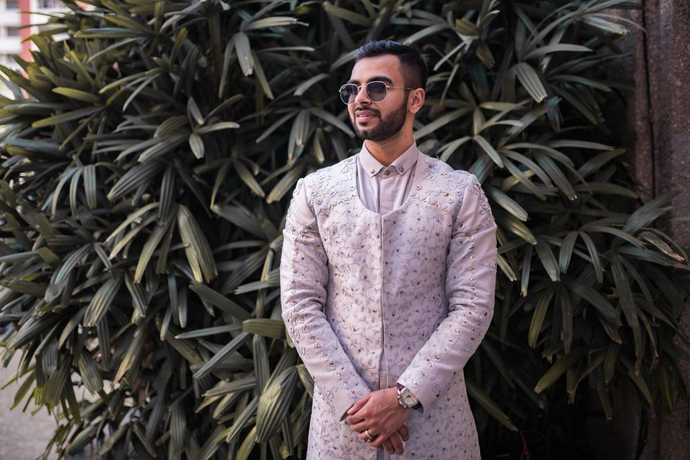 Photo of Groom in a lavender Indo western outfit.