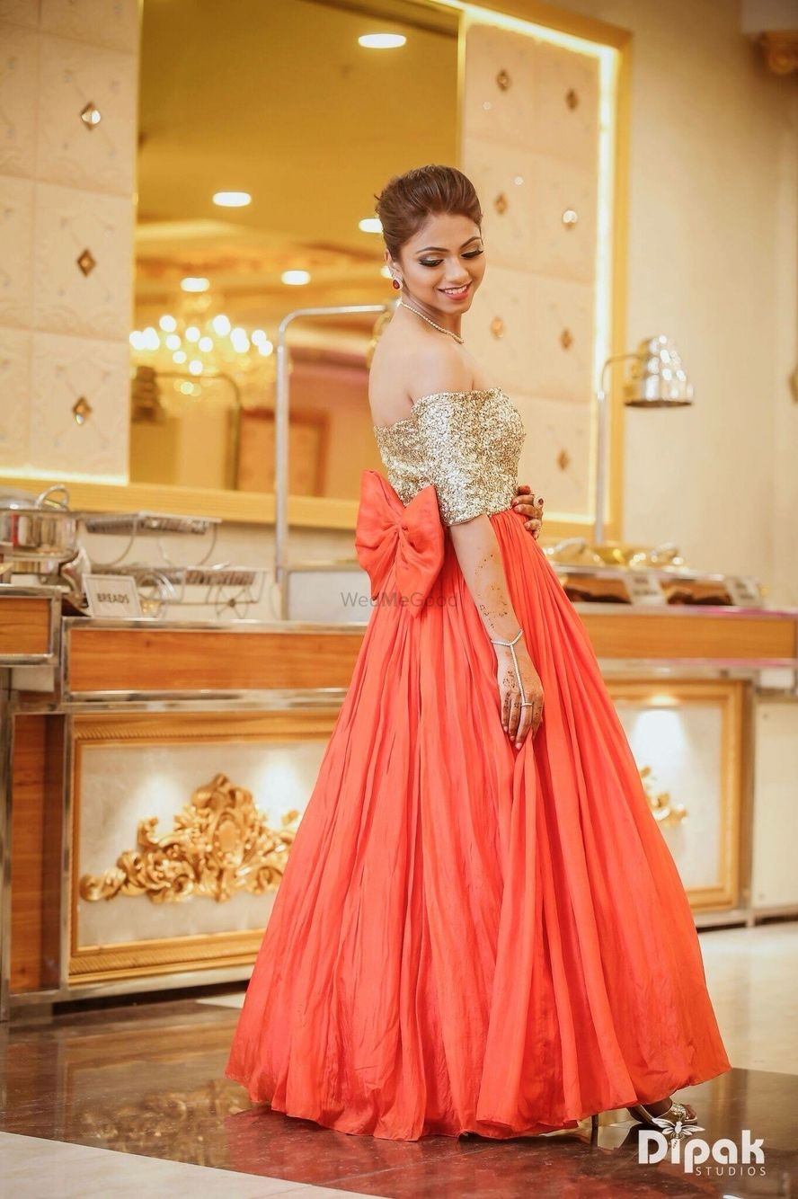 Photo of Orange and gold gown with bow design
