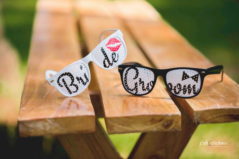 Photo of Bride and groom glasses as props