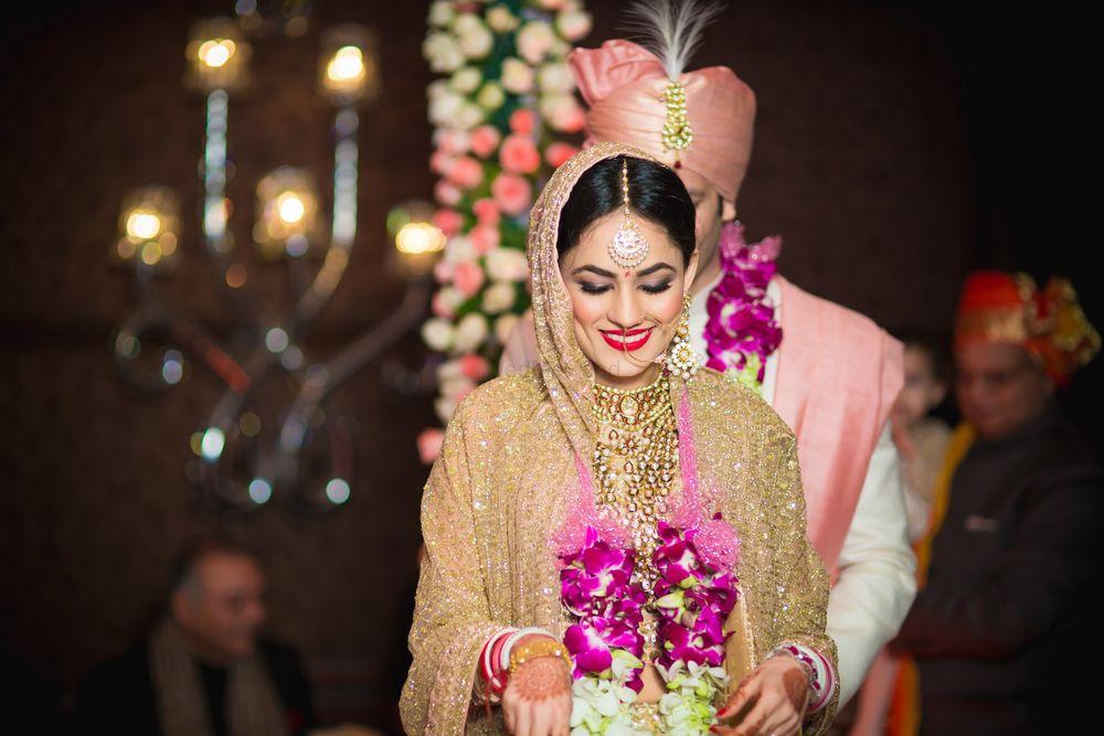 Photo of Bride Wearing Var Mala Shot