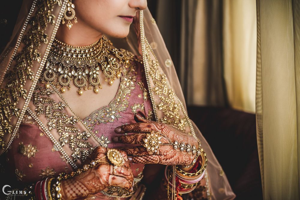 Photo of Bridal jewellery photography with necklace and haathphool