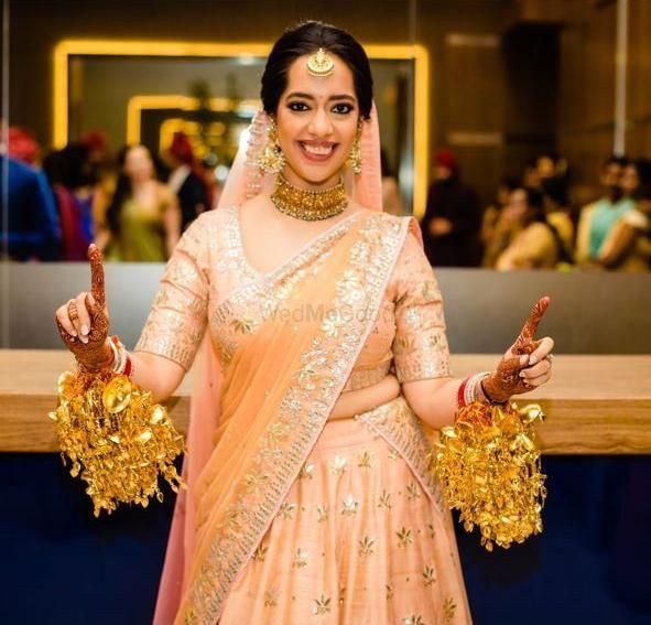 Photo of Simple peach bridal lehenga with kaleere