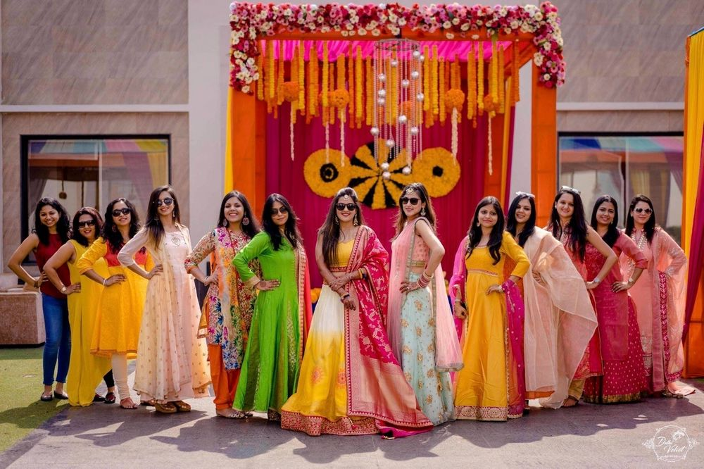 Photo of Bride with her squad on mehendi