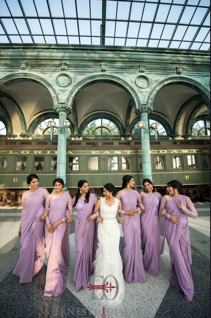 Photo of Bride with bridesmaids in lavender outfits