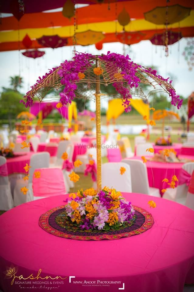 Photo of Parasol style floral centrepiece