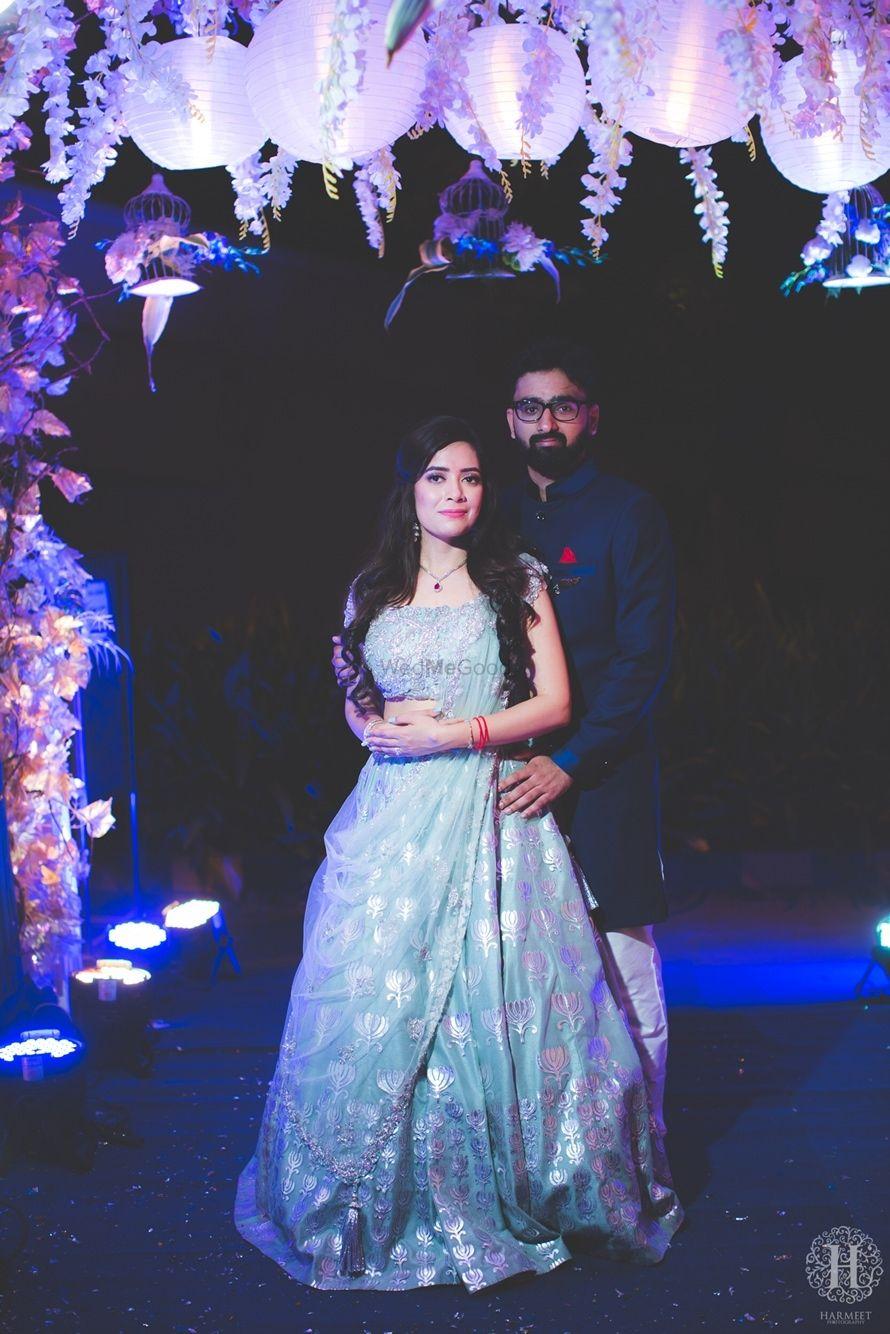Photo of Powder blue engagement lehenga couple portrait