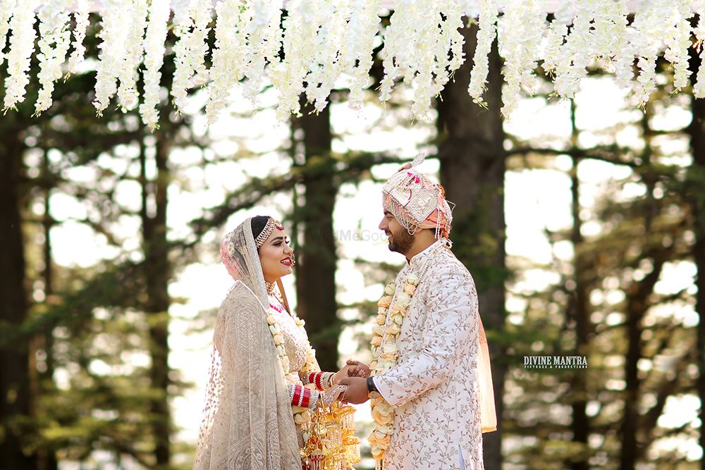 Photo of Jaimala shot in forest wedding with matching bride and groom