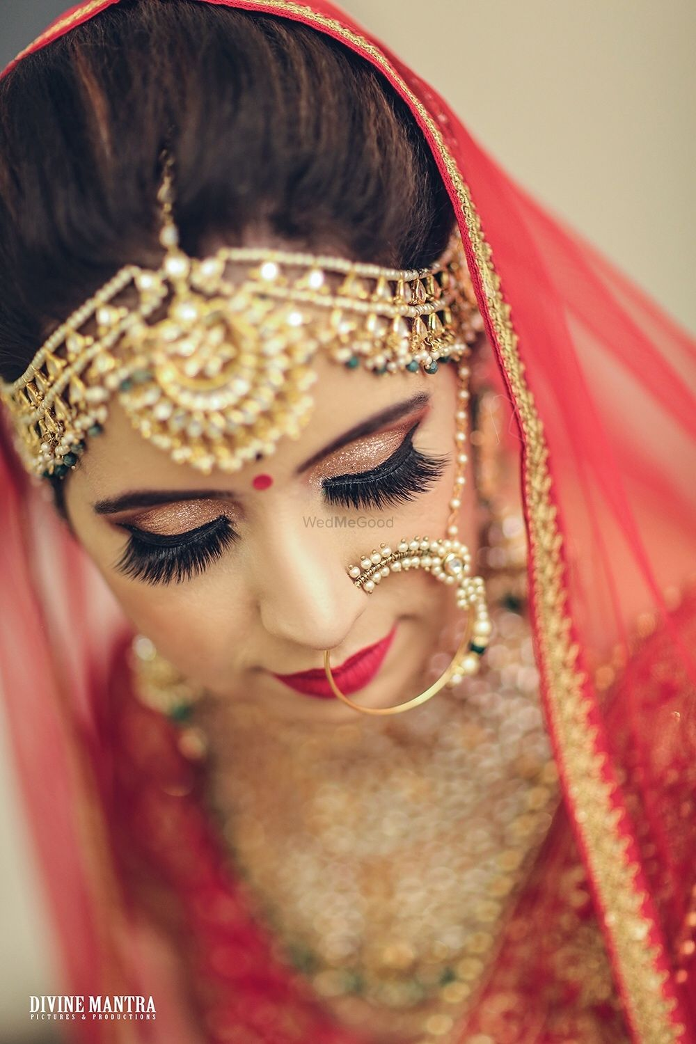 Photo of Heavy bridal mathapatti and Nath with red lehenga