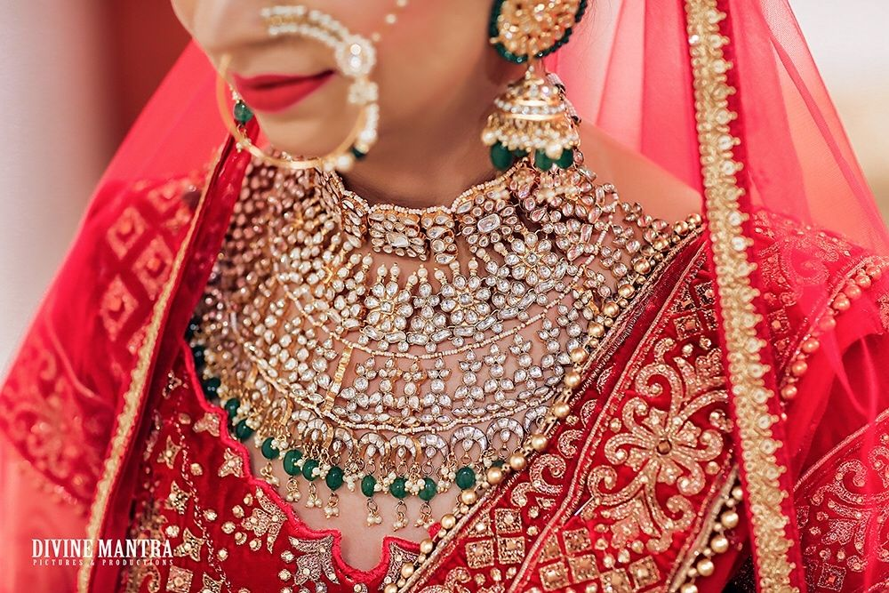 Photo of Elaborate bridal necklace with red lehenga