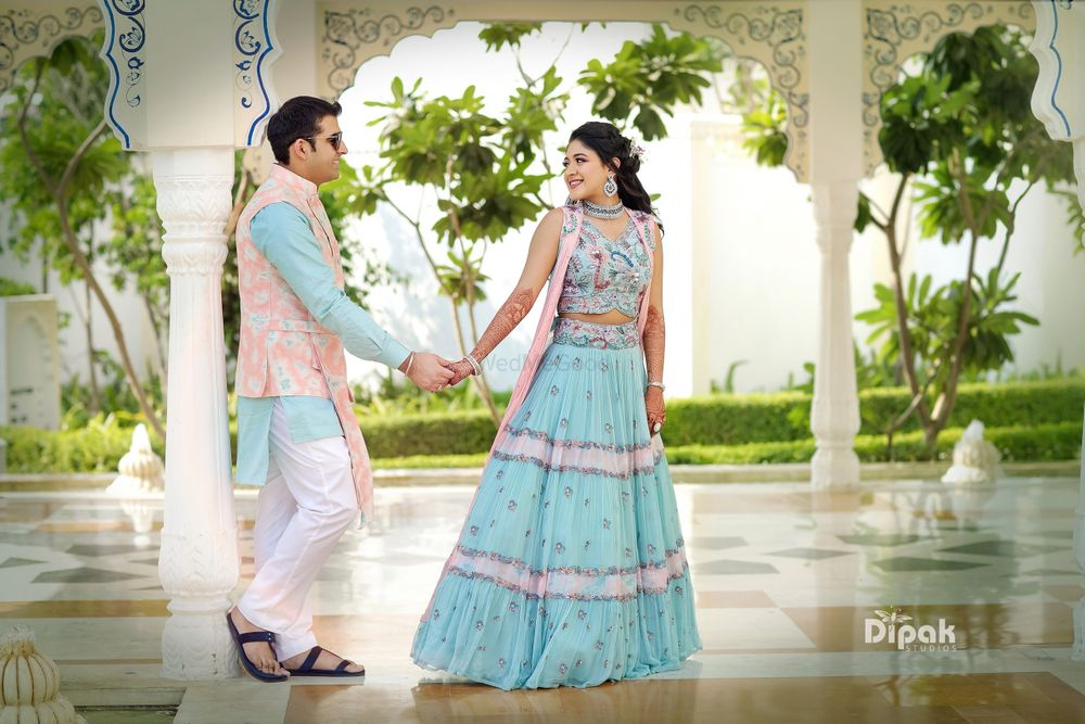 Photo of Coordinated bride and groom in light blue mehendi outfits