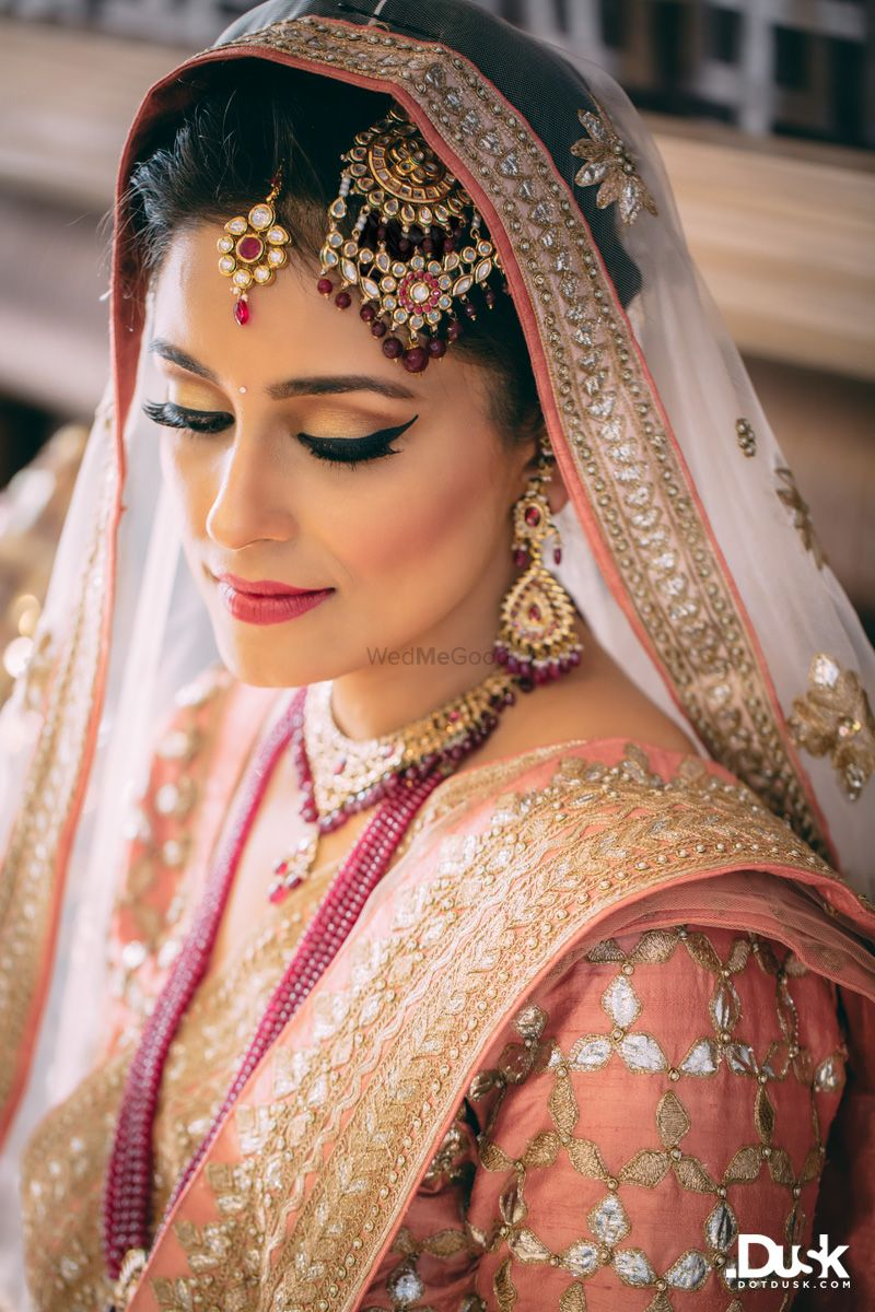 Photo of Peach bridal look with pink lipstick