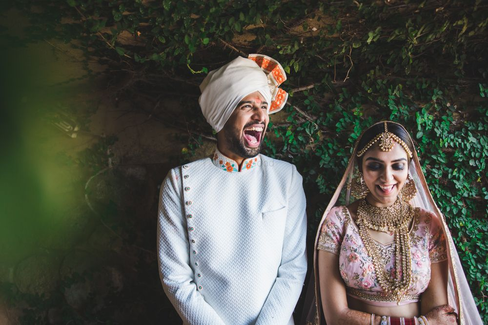 Photo of Bright and happy groom shot couple