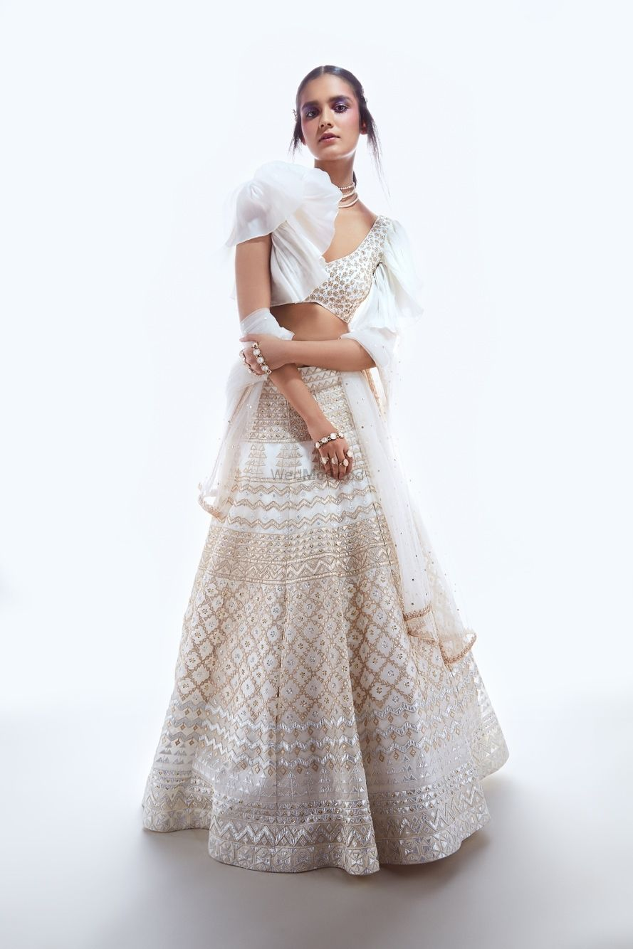 Photo of Sister of the bride lehenga in white with frill sleeves