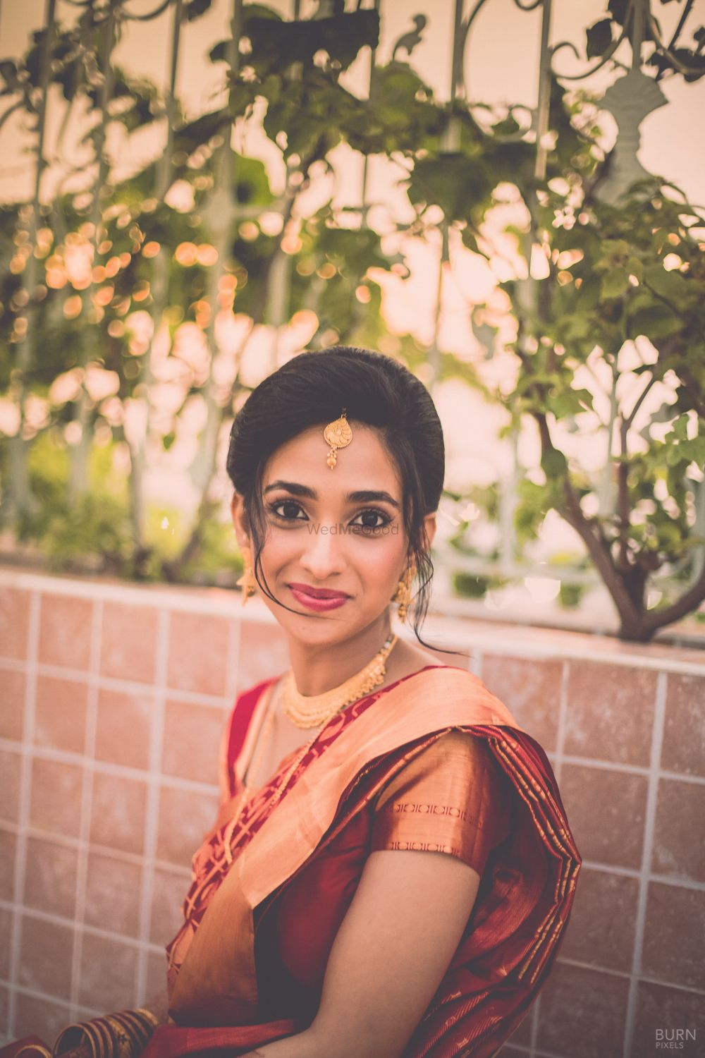Photo of Bride in Red and Gold Saree and Maangtikka