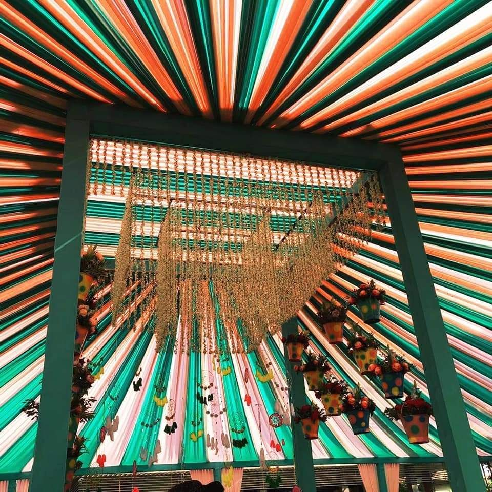 Photo of A unique mogra mandap setup with colored tent