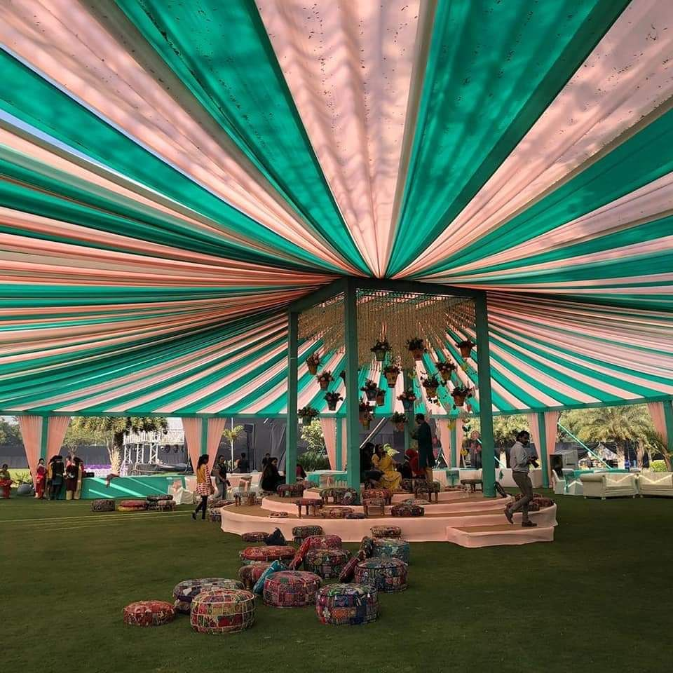 Photo of A pink and green tent decor at a day wedding
