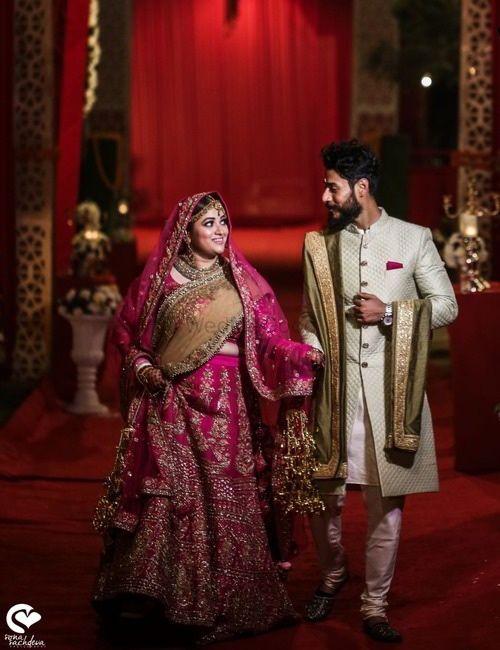 Photo of Couple portrait with bride in pink lehenga