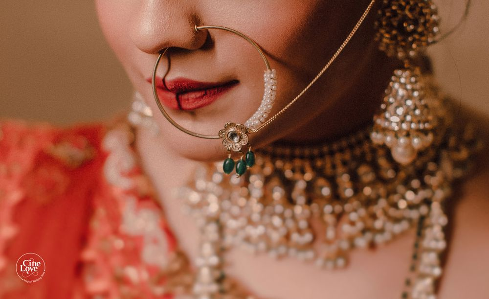 Photo of Bridal Nath with green beads close up shot