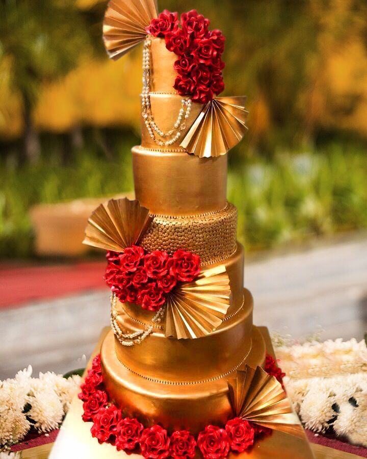 Photo of Glamorous gold and red wedding cake