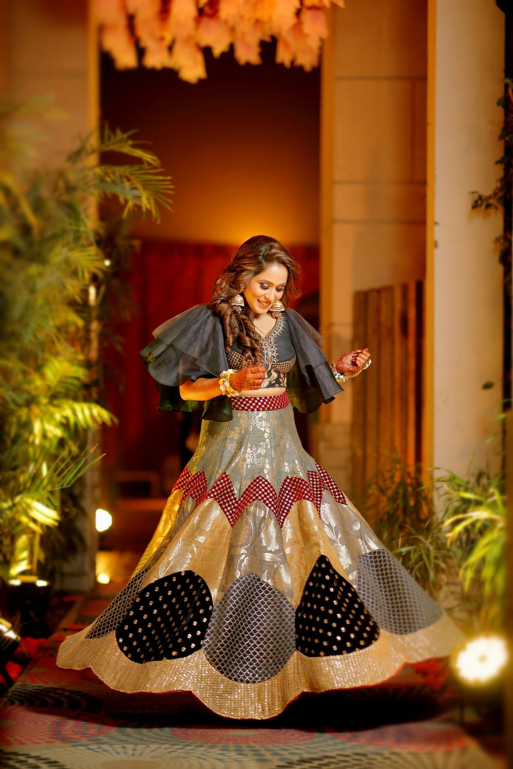 Photo of Patchwork lehenga with black and gold work and cape
